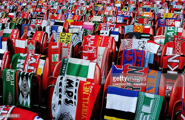 In this handout image provided by Liverpool FC Scarves donated by fans of Liverpool are placed on empty seats during the memorial service marking the...