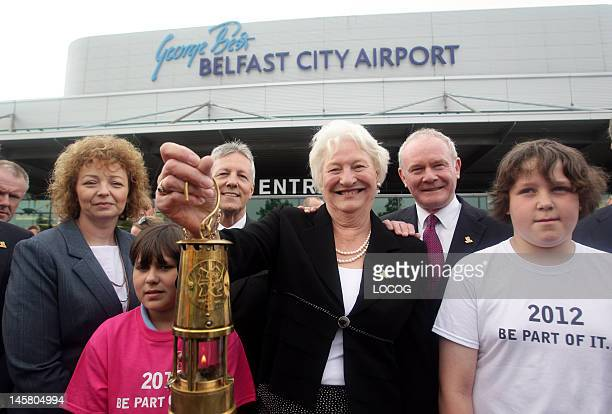 In this handout image provided by LOCOG Dame Mary Peters with the Olympic Flame at George Best Belfast City Airport on day 15 of the London 2012...