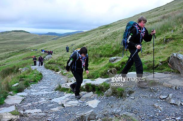 In this handout image provided by LOCOG Groups of disabled and nondisabled Scouts from Gwynedd Scouts ascend Mount Snowdon for the creation of the...