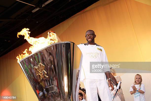 In this handout image provided by LOCOG Torchbearer 143 Fabrice Muamba lights the cauldron at the end of Day 64 of the London 2012 Olympic Torch...
