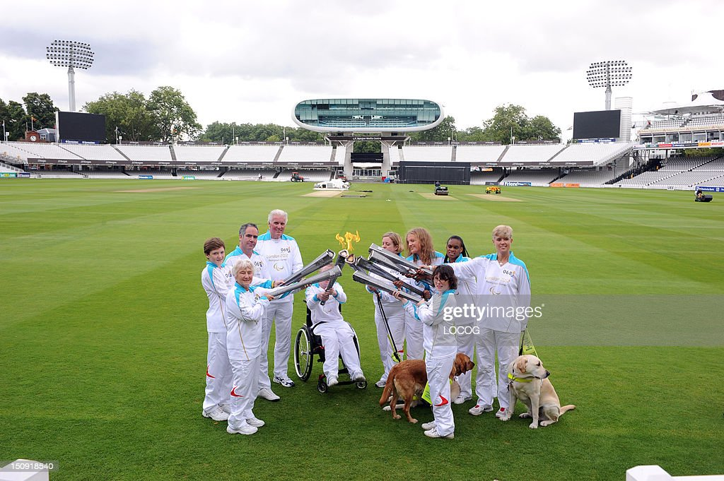 In this handout image provided by LOCOG, Torchbearing team 068 Theresa Robberts, Sarah Clare, Ramona Williams, Diane Marks, Danielle Garratt and Torchbearing team 069 Mark Allen, Gareth Burton, Brian Barnes, and others (no names available) pose with the Paralympic Flame inside Lord's Cricket Ground on the Torch Relay leg on the Torch Relay leg across London, on August 29, 2012 in London, England.
