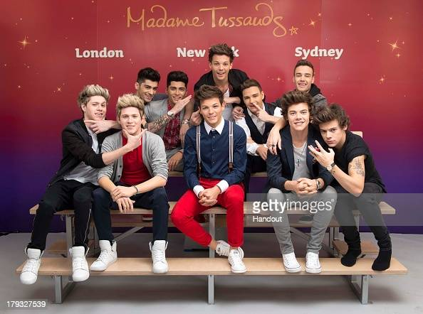 In this handout image provided by Madame Tussauds Niall Horan Zayn Malik Louis Tomlinson Liam Payne and Harry Styles of One Direction pose alongside...