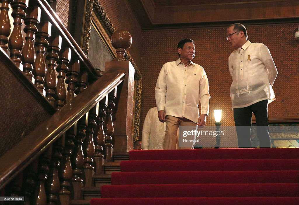 In this handout image provided by Malacanang Photo Bureau, Outgoing President Benigno S. Aquino III with incoming President Rodrigo R. Duterte at the Main Lobby stairs of the Malacanan Palace during the Departure Honors on June 30, 2016 in Manila, Philippines. Rodrigo Duterte, a city mayor also known as 'The Punisher', was sworn in as the 16th president of the Philippines on Thursday to serve a six-year term while promising to get rid of crime and corruption.