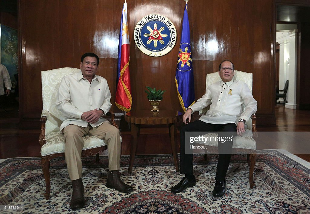 In this handout image provided by Malacanang Photo Bureau, Outgoing President Benigno S. Aquino III talks to incoming President Rodrigo R. Duterte at the Presidents Hall Sala of the Malacanan Palace during the Departure Honors on June 30, 2016 in Manila, Philippines. Rodrigo Duterte, a city mayor also known as 'The Punisher', was sworn in as the 16th president of the Philippines on Thursday to serve a six-year term while promising to get rid of crime and corruption.