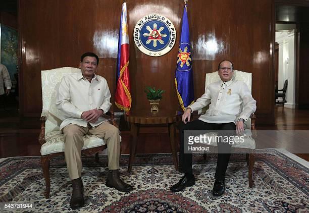 In this handout image provided by Malacanang Photo Bureau Outgoing President Benigno S Aquino III talks to incoming President Rodrigo R Duterte at...