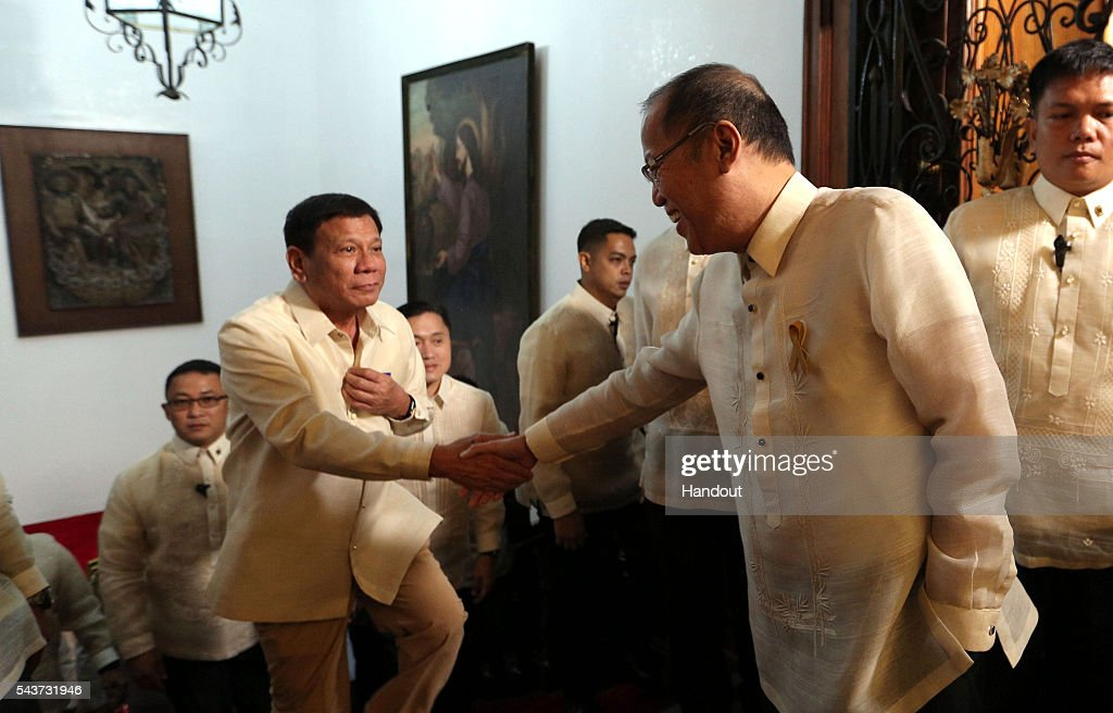 In this handout image provided by Malacanang Photo Bureau, Outgoing President Benigno S. Aquino III shakes hands with incoming President Rodrigo R. Duterte at the Side Lobby of the Malacanan Palace during the Departure Honors on June 30, 2016 in Manila, Philippines. Rodrigo Duterte, a city mayor also known as 'The Punisher', was sworn in as the 16th president of the Philippines on Thursday to serve a six-year term while promising to get rid of crime and corruption.