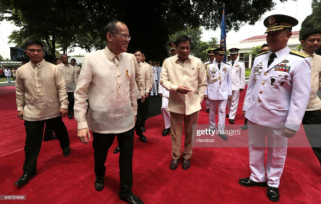 In this handout image provided by Malacanang Photo Bureau, Outgoing President Benigno S. Aquino III bids goodbye after the Departure Honors at the Malacanan Palace Grounds on June 30, 2016 in Manila, Philippines. Rodrigo Duterte, a city mayor also known as 'The Punisher', was sworn in as the 16th president of the Philippines on Thursday to serve a six-year term while promising to get rid of crime and corruption.