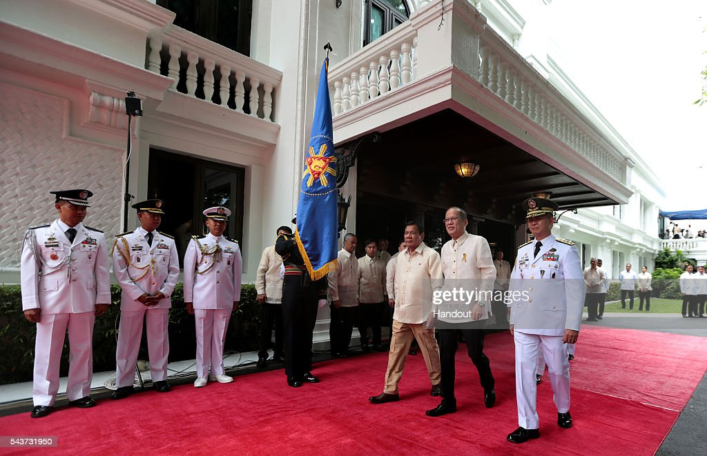In this handout image provided by Malacanang Photo Bureau, Outgoing President Benigno S. Aquino III reviews the honor guards during the Departure Honors at the Malacanan Palace Grounds on June 30, 2016 in Manila, Philippines. Rodrigo Duterte, a city mayor also known as 'The Punisher', was sworn in as the 16th president of the Philippines on Thursday to serve a six-year term while promising to get rid of crime and corruption.