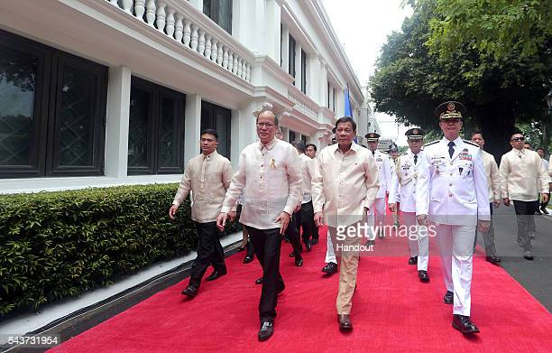 In this handout image provided by Malacanang Photo Bureau Outgoing President Benigno S Aquino III bids goodbye after the Departure Honors at the...