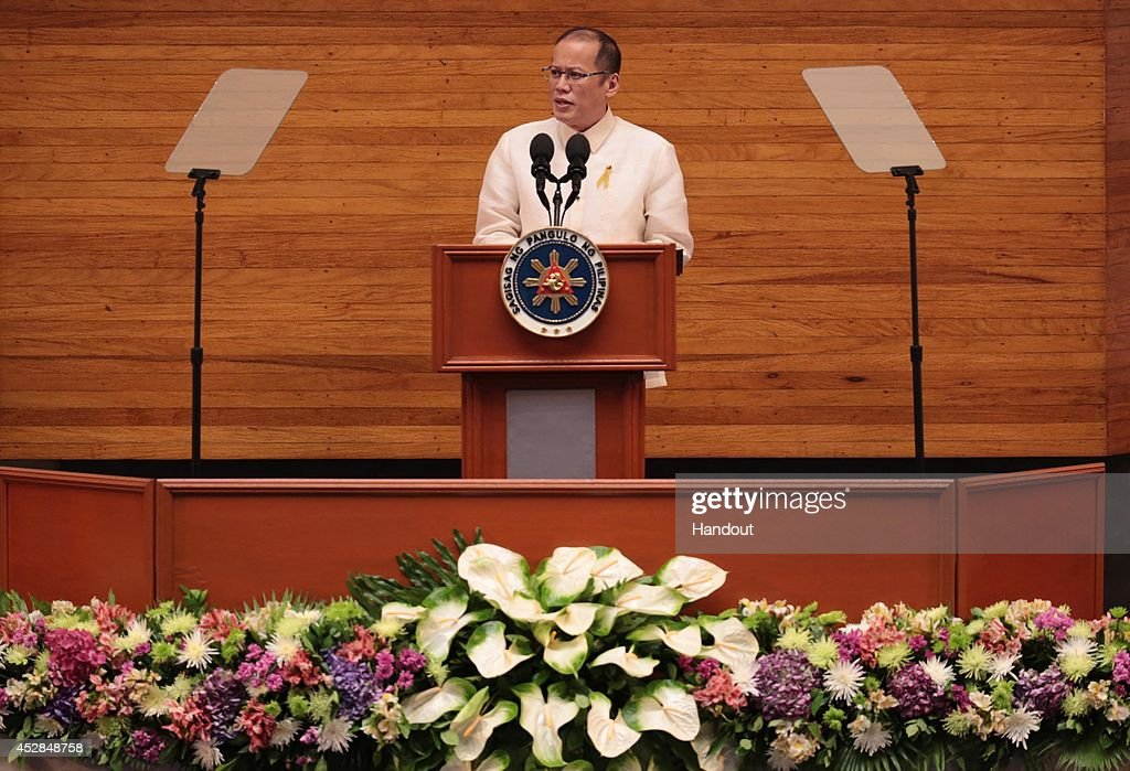 In this handout image provided by Malacanang Photo Bureau, Philippines President Benigno Aquino speaks delivers his Annual State of the Nation Address on July 28, 2014 in Manila, Philippines. Aquino popularity ratings has dropped in his last two years in office as allegations of alleged misuse of the Disbursement Allocation Programme, a 145-billion-peso ($3.34-billion) fund to boost public spending went to political allies.