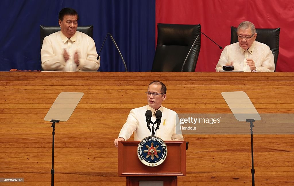 In this handout image provided by Malacanang Photo Bureau, Philippines President Benigno Aquino, center, is flanked by Senate president Franklin Drilon (L), and House Majority leader Feliciano Belmonte (R) during his Annual State of the Nation Address on July 28, 2014 in Manila, Philippines. Aquino popularity ratings has dropped in his last two years in office as allegations of alleged misuse of the Disbursement Allocation Programme, a 145-billion-peso ($3.34-billion) fund to boost public spending went to political allies.
