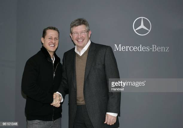 In this handout image provided by Mercedes GP Michael Schumacher shakes hands with team principal Ross Brawn on December 23 2009 in Brackley England...