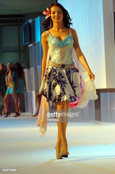In this handout image provided by Miss Universe LP LLLP Natalia Nikolaeva Miss Russia 2005 participates in a fashion show by BSC Swimsuits at...