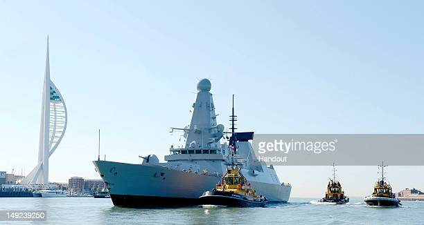 In this handout image provided by MoD Crown Copyright The Royal Navy's newest Type 45 Destroyer HMS Defender sails into her new home at HM Naval Base...