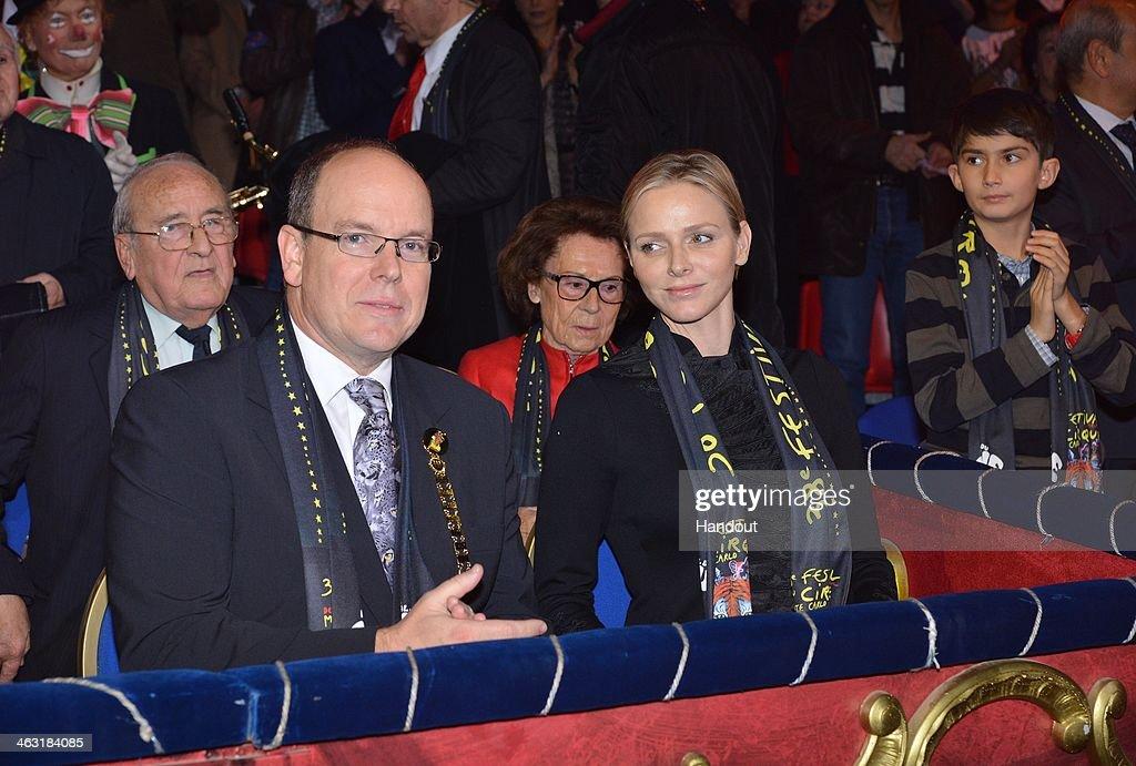 In this handout image provided by Monaco Centre de Presse, Prince Albert II of Monaco and Princess Charlene of Monaco attend the 38th International Circus Festival on January 16, 2014 in Monte-Carlo, Monaco.