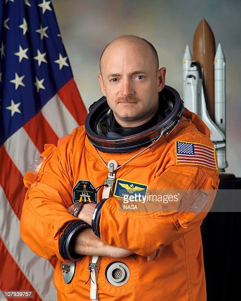In this handout image provided by NASA astronaut Mark E Kelly poses for a photo January 5 2005 in Houston Texas Mark E Kelly's wife US Rep Gabrielle...