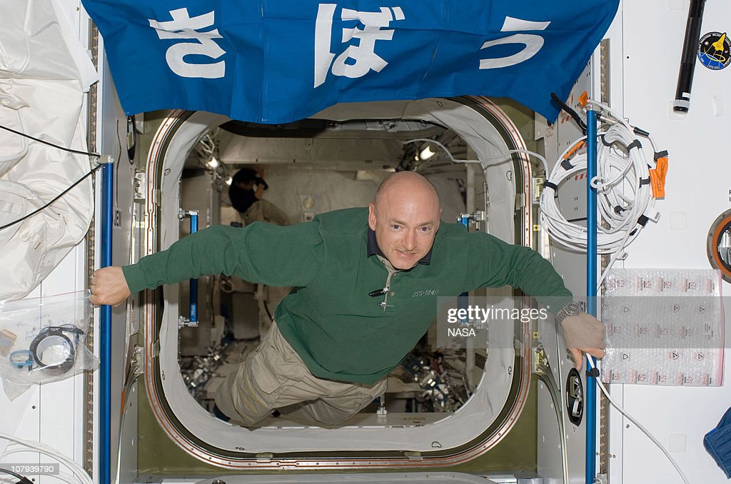 In this handout image provided by NASA astronaut Mark E Kelly STS124 commander floats in the hatch between the Harmony node and the newly installed...