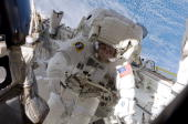 In this handout image provided by NASA Astronaut Tim Kopra mission specialist starts a series of five spacewalk sessions of ISSrelated extravehicular...