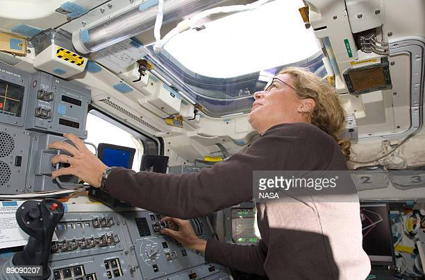 In this handout image provided by NASA Canadian Space Agency astronaut Julie Payette STS127 mission specialist looks through an overhead window while...