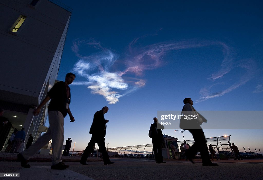 In this handout image provided by NASA, contrails are seen as workers leave the Launch Control Center after the launch of the space shuttle Discovery and the start of the STS-131 mission at NASA Kennedy Space Center in Cape Canaveral, Fla. on Monday April 5, 2010. Discovery is carrying a multi-purpose logistics module filled with science racks for the laboratories aboard the station. The mission has three planned spacewalks, with work to include replacing an ammonia tank assembly, retrieving a Japanese experiment from the station's exterior, and switching out a rate gyro assembly on the station's truss structure.