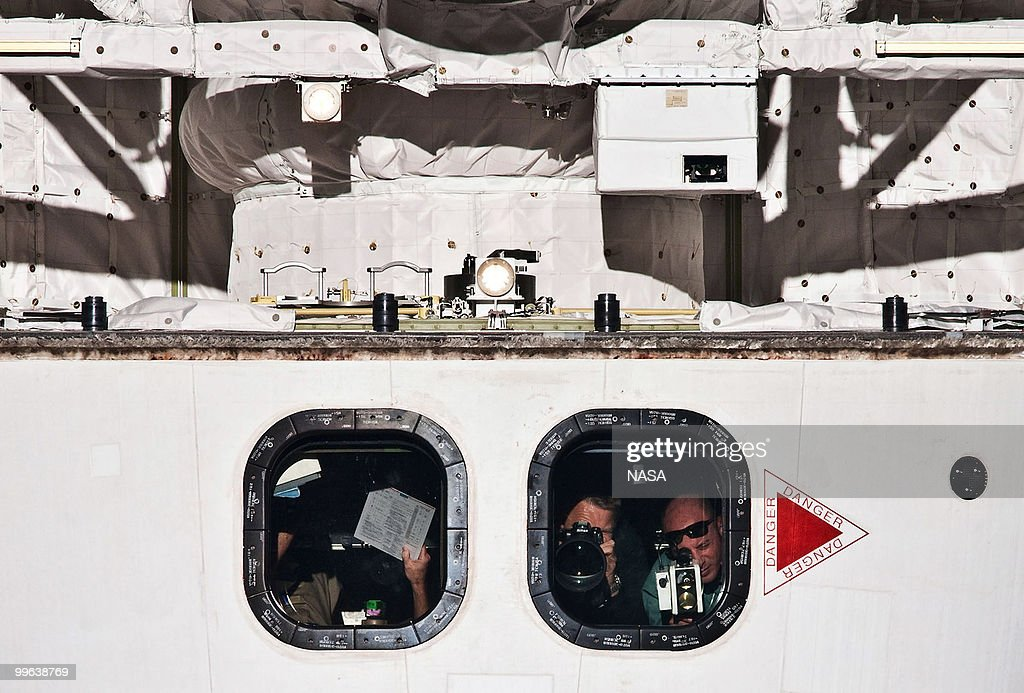In this handout image provided by NASA, Expedition 23 crew members take pictures from the crew cabin of the space shuttle Atlantis during a survey of the approaching STS-132 vehicle prior to docking with the International Space Station on Flight Day Three on May 16, 2010 in space. This is the final scheduled mission for Atlantis and it will dock with the International Space Station to deliver a payload of a new Russian compartment and fresh batteries.
