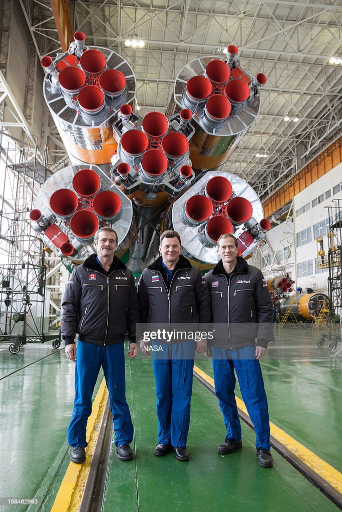 In this handout image provided by NASA, (L-R) Expedition 34/35 Flight Engineer Chris Hadfield of the Canadian Space Agency, Soyuz Commander <a gi-track='captionPersonalityLinkClicked' href=/galleries/search?phrase=Roman+Romanenko&family=editorial&specificpeople=5871562 ng-click='$event.stopPropagation()'>Roman Romanenko</a> and Flight Engineer Tom Marshburn of NASA pose in front pose in front of the cluster of first stage boosters of the Soyuz TMA-07M spacecraft at the completion of the final dress rehearsal for their launch, at the Integration Facility at the Baikonur Cosmodrome on December 14, 2012 on Baikonur, Kazakhstan. Launch of the Soyuz rocket is scheduled for December 19 and will send the astronauts on a five-month mission aboard the International Space Station.