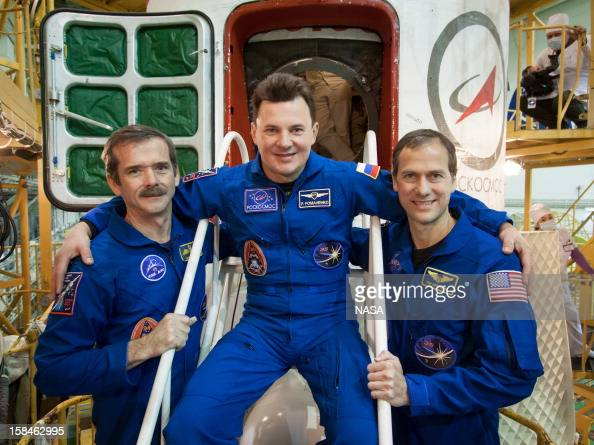 In this handout image provided by NASA Expedition 34/35 Flight Engineer Chris Hadfield of the Canadian Space Agency Soyuz Commander Roman Romanenko...