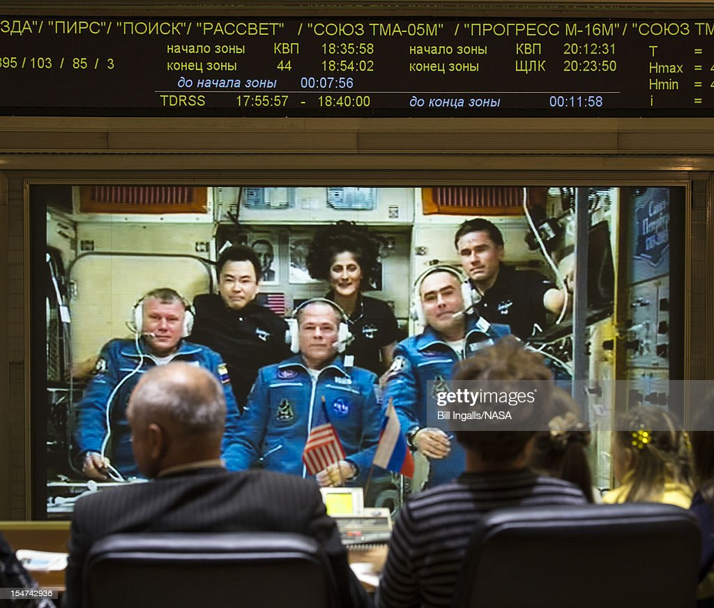 In this handout image provided by NASA, family of the newly arrived International Station Expedition 33/34 crew members, Russian cosmonaut Oleg Novitskiy, front left, NASA astronaut Kevin Ford, front center, and Russian cosmonaut Evgeny Tarelkin, front right, talk via phone to the crew from the Russian Mission Control Center shortly after the three joined Flight Engineer Aki Hoshide of the Japan Aerospace Exploration Agency, back left, Expedition 33 Commander Sunita Williams of NASA, back center, and Yuri Malenchenko of the Russian Federal Space Agency October 25, 2012 in Korolev, Russia. The Soyuz TMA-06M with Expedition 33/34 crew members, NASA astronaut Kevin Ford and Russian cosmonauts Oleg Novitskiy and Evgeny Tarelkin launched from the Baikonur Cosmodrome in Kazakhstan two days ago. The Soyuz crew members were greeted by Expedition 33 Commander Sunita Williams of NASA and Flight Engineers Aki Hoshide of the Japan Aerospace Exploration Agency and Yuri Malenchenko of the Russian Federal Space Agency, who have lived in the orbital laboratory since July.