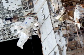 In this handout image provided by NASA NASA astronaut Alvin Drew participates in the mission's first session of extravehicular activity as...
