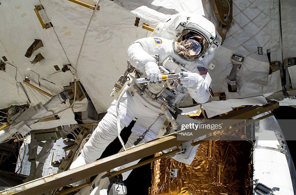 In this handout image provided by NASA, NASA astronaut Alvin Drew participates in the mission's first session of extravehicular activity (EVA) as construction and maintenance continue on the International Space Station February 28, 2011 in Space. During the six-hour, 34-minute spacewalk, Steve Bowen and Drew installed the J612 power extension cable, move a failed ammonia pump module to the External Stowage Platform 2 on the Quest Airlock for return to Earth at a later date, installed a camera wedge on the right hand truss segment, installed extensions to the mobile transporter rail and exposed the Japanese 'Message in a Bottle' experiment to space. Discovery, on its 39th and final flight, is carrying the Italian-built Permanent Multipurpose Module (PMM), Express Logistics Carrier 4 (ELC4) and Robonaut 2, the first humanoid robot in space to the International Space Station.