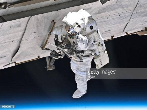 In this handout image provided by NASA NASA astronaut Garrett Reisman STS132 mission specialist participates in the mission's first session of...