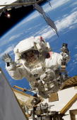 In this handout image provided by NASA NASA astronaut Steve Bowen STS132 mission specialist participates in the mission's first session of...