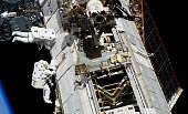 In this handout image provided by NASA NASA astronauts Steve Bowen and Alvin Drew both STS133 mission specialists participate in the mission's first...