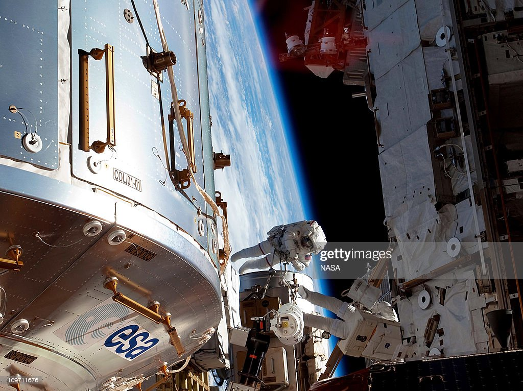 In this handout image provided by NASA, NASA astronauts Steve Bowen and Alvin Drew, both STS-133 mission specialists, participate in the mission's first session of extravehicular activity (EVA) as construction and maintenance continue on the International Space Station February 28, 2011 in Space. During the six-hour, 34-minute spacewalk, Bowen and Drew installed the J612 power extension cable, move a failed ammonia pump module to the External Stowage Platform 2 on the Quest Airlock for return to Earth at a later date, installed a camera wedge on the right hand truss segment, installed extensions to the mobile transporter rail and exposed the Japanese 'Message in a Bottle' experiment to space. Discovery, on its 39th and final flight, is carrying the Italian-built Permanent Multipurpose Module (PMM), Express Logistics Carrier 4 (ELC4) and Robonaut 2, the first humanoid robot in space to the International Space Station.