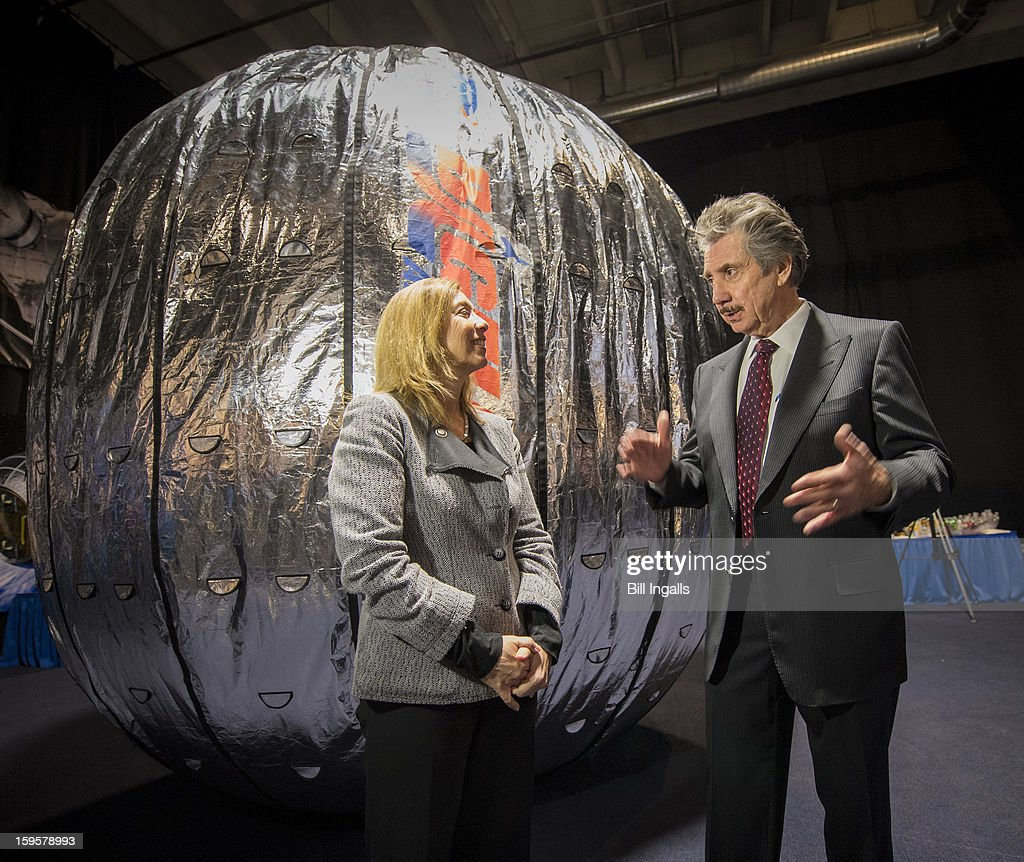 In this handout image provided by NASA, NASA Deputy Administrator Lori Garver (L) and President and founder of Bigelow Aerospace Robert T. Bigelow talk while standing next to the Bigelow Expandable Activity Module (BEAM) during a media briefing where is was announced that the BEAM expandable space habitat technology will be tested on the International Space Station on January 16, 2013 in Las Vegas, Nevada. The $17.8 million contract with Bigelow Aerospace will provide a Bigelow Expandable Activity Module (BEAM), which is scheduled to arrive at the space station in 2015 for a two-year technology demonstration.