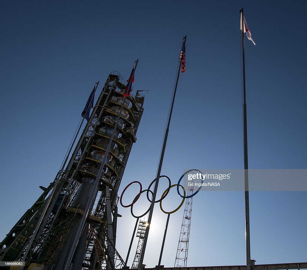 In this handout image provided by NASA Olympic rings are seen at the Soyuz launch pad shortly after the Soyuz TMA11M rocket was erected into position...