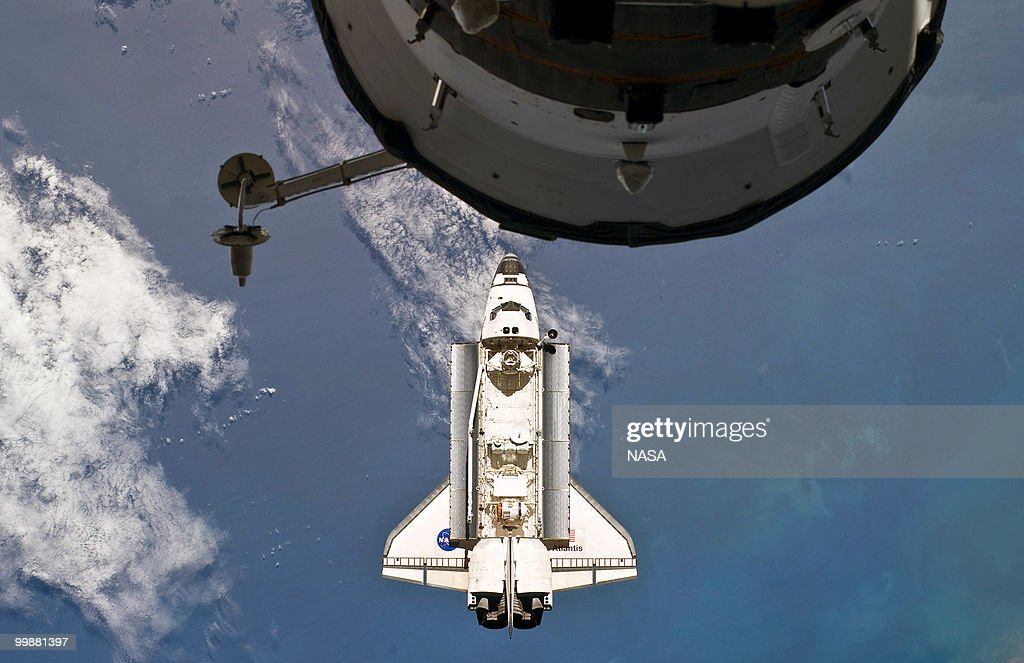 In this handout image provided by NASA, space shuttle Atlantis is seen as it approaches the International Space Station during STS-132 rendezvous and docking operations on May 16, 2010 in space. Docking occurred at 9:28 a.m. (CDT) on May 16, 2010. A portion of a docked Russian spacecraft is visible at top. This is the final scheduled mission for Atlantis and it will dock with the International Space Station to deliver a payload of a new Russian compartment and fresh batteries.