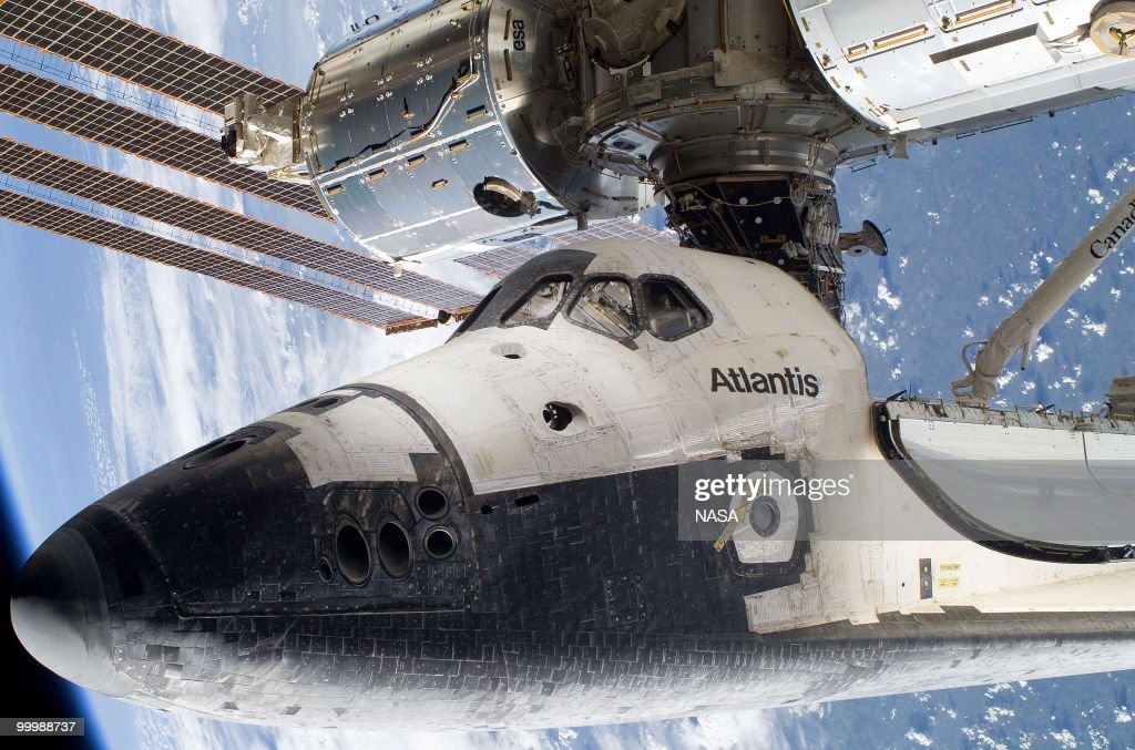 In this handout image provided by NASA, space shuttle Atlantis is docked to the International Space Station on May 17, 2010 in space. This is the final scheduled mission for Atlantis and it will dock with the International Space Station to deliver a payload of a new Russian compartment and fresh batteries.