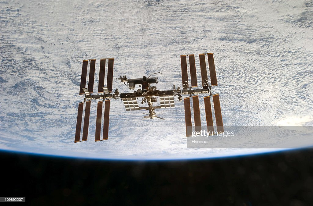 In this handout image provided by NASA, the International Space Station is seen from the space shuttle Discovery as the two orbital spacecraft accomplish their relative separation after an aggregate of 12 astronauts and cosmonauts worked together for over a week during flight day 12 activities March 7, 2011 in Space. Discovery, on its 39th and final flight, is carrying the Italian-built Permanent Multipurpose Module (PMM), Express Logistics Carrier 4 (ELC4) and Robonaut 2, the first humanoid robot in space to the International Space Station. Discovery was in service for 27 years and will be decommissioned and sent to a museum. Two remaining shuttle missions are planned before the program ends.