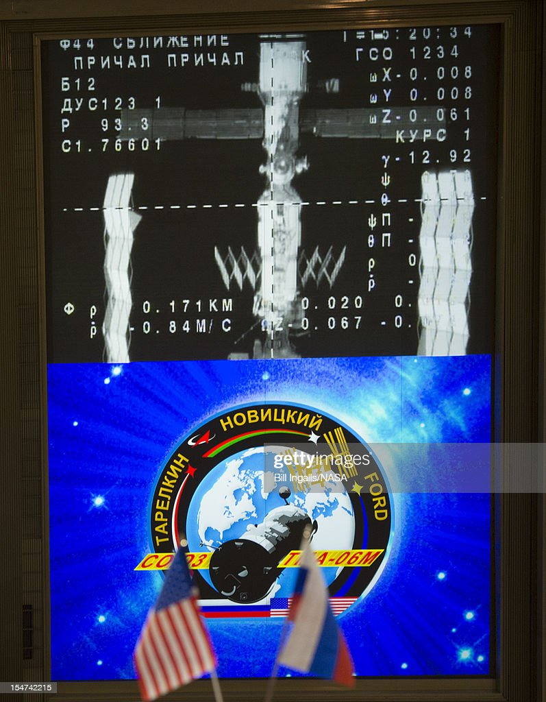 In this handout image provided by NASA, the International Space Station is seen from the Soyuz TMA-06M on the screen of the Russian Mission Control Center as the spacecraft docks to the Poisk module October 25, 2012 in Korolev, Russia. The Soyuz TMA-06M with Expedition 33/34 crew members, NASA astronaut Kevin Ford and Russian cosmonauts Oleg Novitskiy and Evgeny Tarelkin launched from the Baikonur Cosmodrome in Kazakhstan two days ago. The Soyuz crew members will be greeted by Expedition 33 Commander Sunita Williams of NASA and Flight Engineers Aki Hoshide of the Japan Aerospace Exploration Agency and Yuri Malenchenko of the Russian Federal Space Agency, who have lived in the orbital laboratory since July.