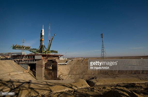 In this handout image provided by NASA the Soyuz rocket is erected into position at the launch pad March 24 2009 at the Baikonur Cosmodrome in...