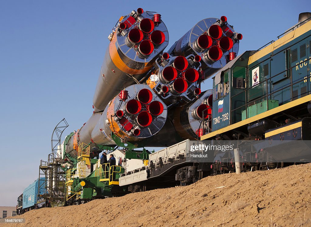 In this handout image provided by NASA, the Soyuz rocket is rolled out to the launch pad by train on March 26, 2013, at the Baikonur Cosmodrome in Kazakhstan. Launch of the Soyuz rocket is scheduled for March 29 and will send Expedition 35 Soyuz Commander Pavel Vinogradov, and Flight Engineers Chris Cassidy of NASA and Alexander Misurkin of Russia on a five and a half-month mission aboard the International Space Station.