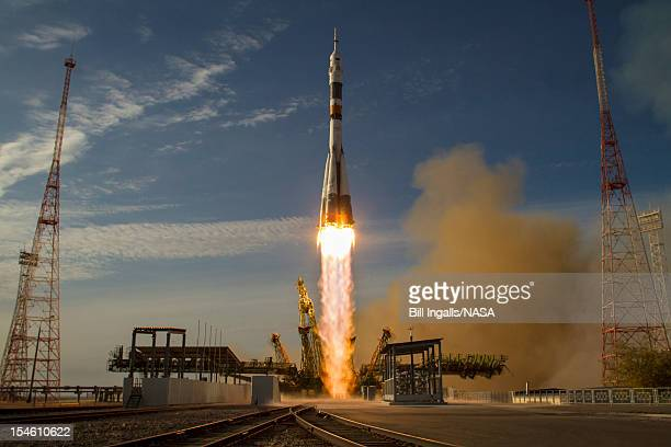 In this handout image provided by NASA the Soyuz rocket with Expedition 33/34 crew members Soyuz Commander Oleg Novitskiy Flight Engineer Kevin Ford...