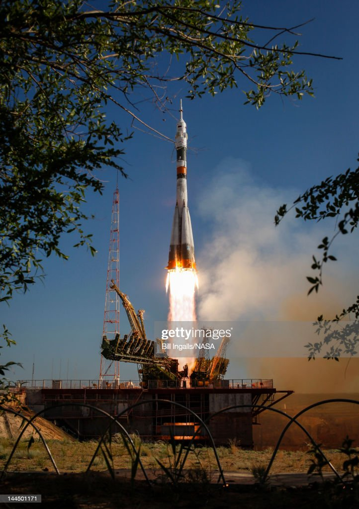 In this handout image provided by NASA, The Soyuz TMA-04M rocket launches from the Baikonur Cosmodrome on May 15, 2012 in Baikonur, Kazakhstan. The rocket is carrying Expedition 31 Soyuz Commander Gennady Padalka, NASA Flight Engineer Joseph Acaba and Flight Engineer Sergei Revin to the International Space Station.