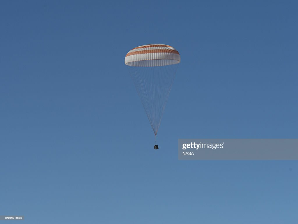 In this handout image provided by NASA, The Soyuz TMA-07M spacecraft lands with Expedition 35 Commander Chris Hadfield of the Canadian Space Agency (CSA), NASA Flight Engineer Tom Marshburn and Russian Flight Engineer Roman Romanenko of the Russian Federal Space Agency (Roscosmos) on May 14, 2013 in a remote area near the town of Dzhezkazgan, Kazakhstan. Hadfield, Marshburn and Romanenko returned from five months onboard the International Space Station where they served as members of the Expedition 34 and 35 crews.