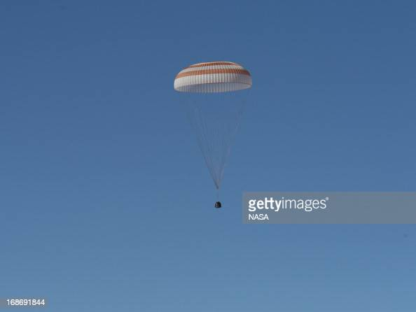 In this handout image provided by NASA The Soyuz TMA07M spacecraft lands with Expedition 35 Commander Chris Hadfield of the Canadian Space Agency...