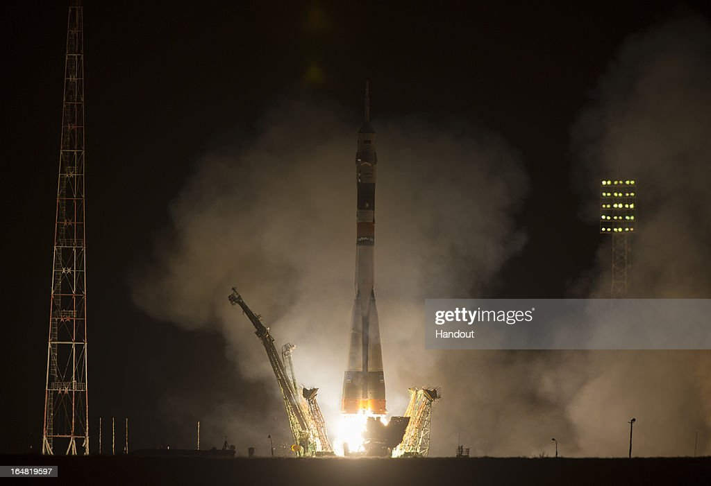 In this handout image provided by NASA, the Soyuz TMA-08M rocket launches from the Baikonur Cosmodrome carrying Expedition 35 Russian Flight Engineer Aleksandr Misurkin, NASA Flight Engineer Chris Cassidy, and Soyuz Commander Pavel Vinogradov March 29, 2013 in Baikonur, Kazakhstan. The Soyuz TMA-08M rocket launched at 2:43 a.m. local time to transport the crew to the International Space Station.