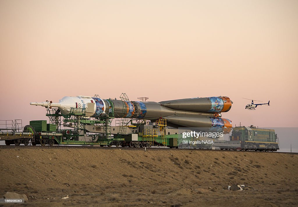 In this handout image provided by NASA The Soyuz TMA11M rocket adorned with the logo of the Sochi Olympic Organizing Committee and other related...