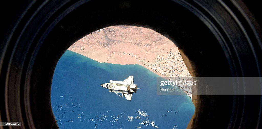 In this handout image provided by NASA, the space shuttle Discovery is seen from the International Space Station as the two orbital spacecraft accomplish their relative separation after an aggregate of 12 astronauts and cosmonauts worked together for over a week during flight day 12 activities March 7, 2011 in Space. Discovery, on its 39th and final flight, is carrying the Italian-built Permanent Multipurpose Module (PMM), Express Logistics Carrier 4 (ELC4) and Robonaut 2, the first humanoid robot in space to the International Space Station. Discovery was in service for 27 years and will be decommissioned and sent to a museum. Two remaining shuttle missions are planned before the program ends.