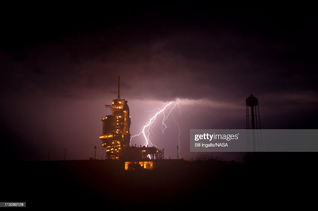 In this handout image provided by NASA, the space shuttle Endeavour is seen on launch pad 39a as a storm passes by prior to the rollback of the Rotating Service Structure (RSS) April 28, 2011, at Kennedy Space Center in Cape Canaveral, Florida. During the 14-day mission, Endeavour and the STS-134 crew will deliver the Alpha Magnetic Spectrometer (AMS) and spare parts, including two S-band communications antennas, a high-pressure gas tank and additional spare parts for Dextre. Launch is targeted for April 29 at 3:47 p.m. EDT.